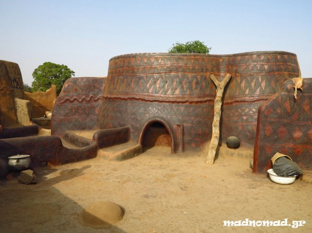 That's how a typical hut of the Gourounsi tribe looks like: no windows, low entrance and symbols embellishing the exterior.