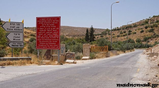 Palestinians are left only with small pieces of land to hang on and the roads are ready to be blockaded at any given time by the Israeli army. The white signs direct Israelis to their illegal settlements.