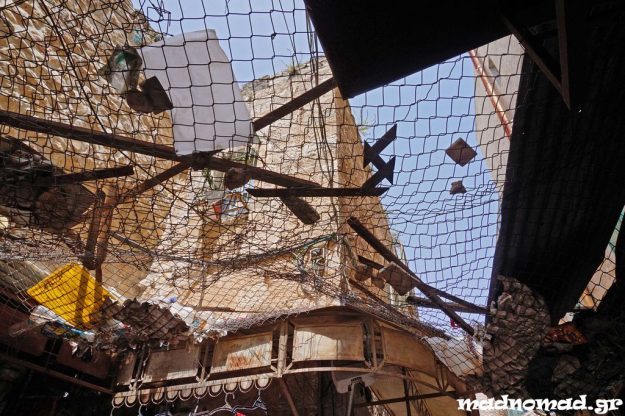 Palestinians in Hebron have installed metal netting over the streets to keep the stones and the rubbish that Israeli settlers throw from upstairs. Then the settlers thought of something else to throw... urine!