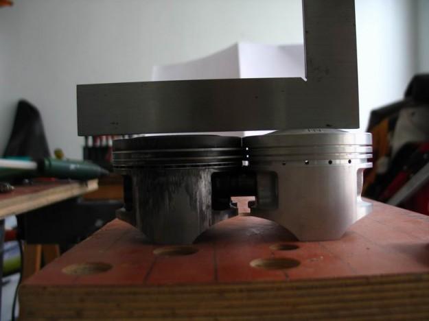 New and old piston comparison